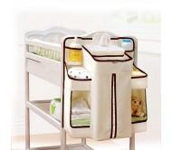 Стильно оформленный органайзер для детской кроватки